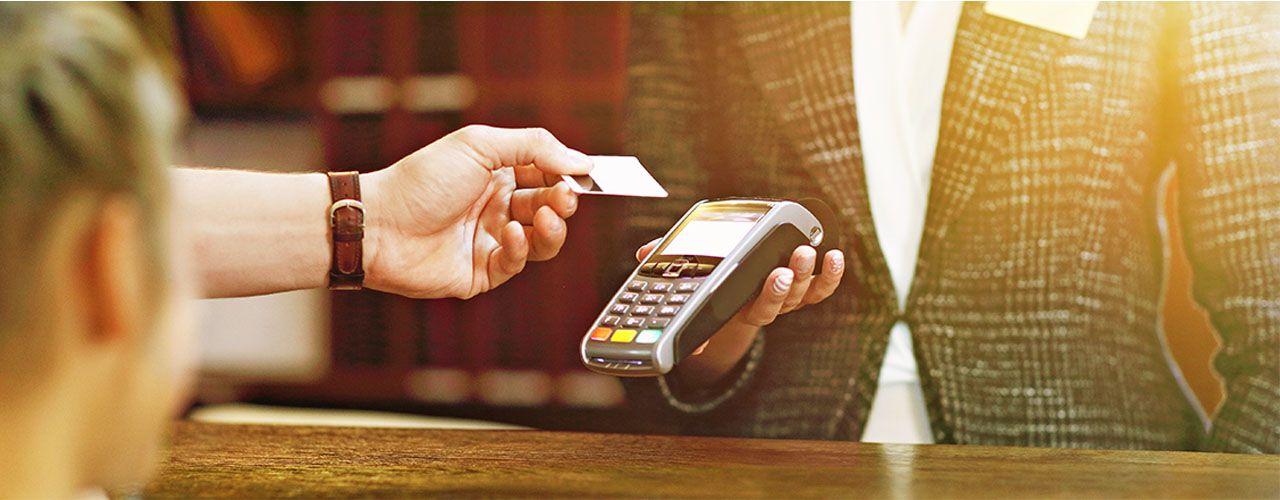 Paying at hotel counter